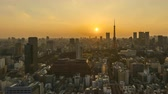 4k time lapse of day to night sunset scene at Tokyo city skyline with Tokyo Tower.
