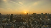 4k time lapse of day to night sunset scene at Tokyo city skyline with Tokyo Tower. Tilt down