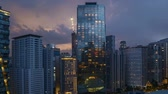 4k UHD time lapse of aerial view sunset day to night at Kuala Lumpur city skyline. Pan right
