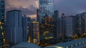 4k UHD time lapse of aerial view sunset day to night at Kuala Lumpur city skyline. Tilt down 動画素材