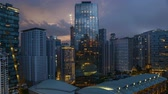 arranha céus : 4k UHD time lapse of aerial view sunset day to night at Kuala Lumpur city skyline. Vídeos