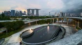 expozice : 4k UHD time lapse of sunset sky day to night at Singapore Marina Bay city skyline. Pan right