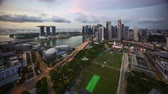 业务 : Sunrise at Marina Bay Singapore. 4k time lapse aerial view.
