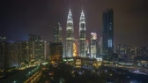 malásia : 4k time lapse of sunset scene at Kuala Lumpur city skyline. Pan right