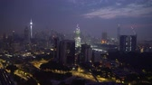 dört : 4k establishing cinematic shot of sunrise blue hour hazy morning at Kuala Lumpur city skyline.