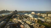 nehrin akıntılı yeri : 4k UHD time lapse of golden sky evening at Sydney city skyline, aerial view. Tilt down Stok Video