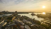balsa : 4k UHD time lapse of sunrise from the horizon of Sydney city skyline, aerial view. Zoom out Stock Footage