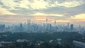 apartment hotel : aerial drone lapse hyperlapse of sunrise at Kuala Lumpur city skyline horizon. Cinematic establishing b-roll shot of drone flying over Kuala Lumpur. Pan right Stock Footage