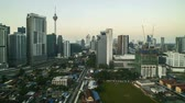 4k time lapse of sunrise at Kuala Lumpur city skyline. Tilt up 動画素材