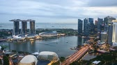 작업장 : Time lapse of sunset day to night at Singapore Marina Bay skyline. Zoom in 무비클립