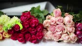 Bouquets of roses lay on the counter in the store.