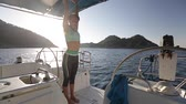 joga : Young slim lady performs morning yoga exercises on board of the sail boat. Set of clips