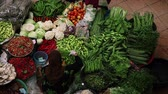 mercado : Person buys food on traditional asian market in the city of Kota Bharu, Malaysia