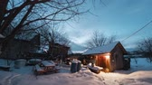 дом : Time lapse of the winter garden with wooden building illuminated by lamp