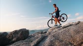 broca : Man walks with bicycle on the rocky terrain Vídeos