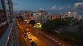 illumination : Night to day tilt timelapse of the street in the city of Tel Aviv. Stock Footage