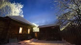 дом : Night to day time lapse of the winter garden with wooden house
