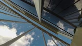 стена : Sunny day sky time lapse with clouds through the metal construction with glass surface Стоковые видеозаписи