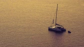 longo : Sail boat anchored in the calm sea Stock Footage