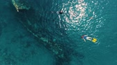 ship : Aerial shoot of the Japanese ship wreck with people snorkeling over it. Bali, Indonesia