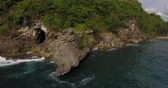 ниже : Aerial shoot of the rock cave at the Crystal bay beach of the island of Nusa Penida, Indonesia