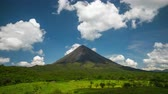 monte : Time lapse of the volcano of Arenal with green meadow at sunny day. Costa Rica