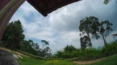 venkov : Timelapse of the sky with summer clouds and wooden building Dostupné videozáznamy