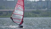 extremo : Windsurfer planing on the lake