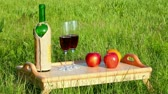 glass : picnic - tabe with wine and fruits