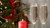 sparkler : glasses with champagne and candle against christmas tree background Stock Footage