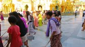 shwedagon : YANGON, MYANMAR - JANUARY 30, 2016: Group of pilgrims participate in a ceremony with brooms at the Shwedagon Pagoda. Shwedagon Pagoda is the most sacred Buddhist pagoda for the Burmese