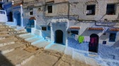 maroc : Panorama of traditional old blue street inside Medina of Chefchaouen, Morocco