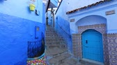 maroc : Panorama of traditional old blue street with color pots inside Medina of Chefchaouen, Morocco Stock Footage