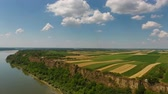 serbia : Aerial view of colorful fields on high bank of Danube river in Serbia, panorama 4k Stock Footage