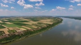 serbia : Aerial view of colorful fields on high bank of Danube river in Serbia, 4k