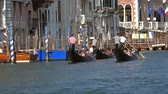 運河 : VENICE, ITALY - CIRCA MAY, 2017: Group of gondolas on the canal in Venice, 4k 動画素材