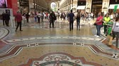 milano : MILAN, ITALY - CIRCA MAY, 2017: Interior of the Milano Galleria Vittorio Emanuele II gallery Lombardy, tilt view 4k Stock Footage