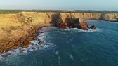 rochoso : Aerial view on the Atlantic coast with cliffs and waves at sunset in Portugal, 4k Stock Footage