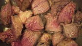 ビーフステーキ : Raw pieces of beef meat fried in a pan closeup, 4k 動画素材