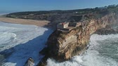leuchtturm : Aerial view of the Atlantic Ocean coastline in Nazare, Portugal, slow motion 4k