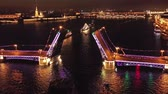 ポール : Aerial around view of the ship sailing under a drawn Palace bridge, Admiralty, Winter Palace, Peter and Paul Fortress and Rostral Columns in St. Petersburg at night, Russia, 4k 動画素材