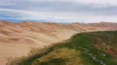 droogte : Aerial view on sand dunes under cloudy sky