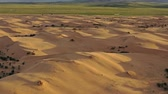 namib desert : Aerial top view on sand dunes in desert at sunset Stock Footage