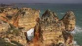 algarve : Rock cliffs and waves in the Algarve, Portugal Stock Footage
