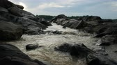 kahverengi : water flowing through the stone on a Mekong river stream Stok Video