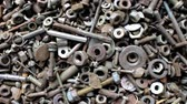 A lot of bolts, screws and nuts of different lengths and different diameters. They move to the right.