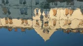 искажение : Reflection in the water of an old building. The waves of the bay marvelously distort the picture of the building.
