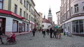 Beautiful views of the city and blue sky. People walking. Timelaps 4K. Fast life concept. Old city in Poland. The central square of the city. In winter before hollidays