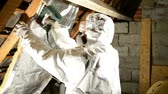 a man placing insulation mineral wool on the attic. Dostupné videozáznamy
