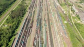 Branches of the railway at the marshalling yard, a lot of freight wagons from the height. Wagons with coal moving on rails Wideo